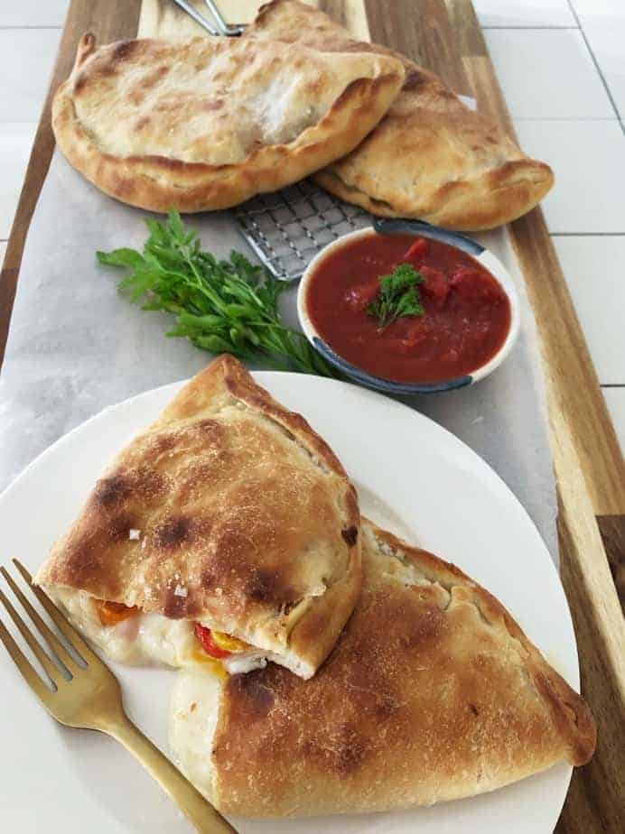 Title.Homemade Calzone cut open and on cutting board