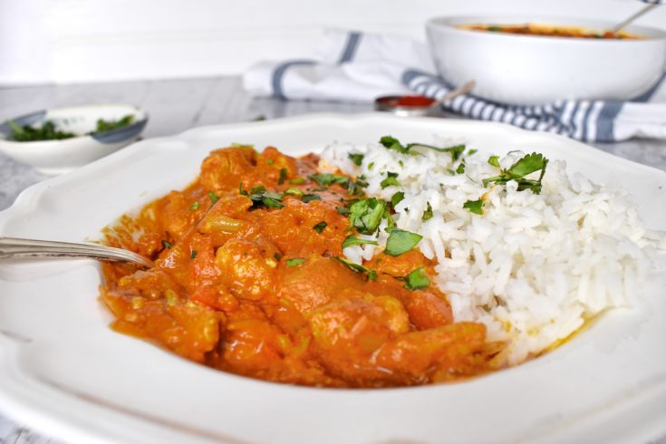 Chicken tikka masala in bowl with rice