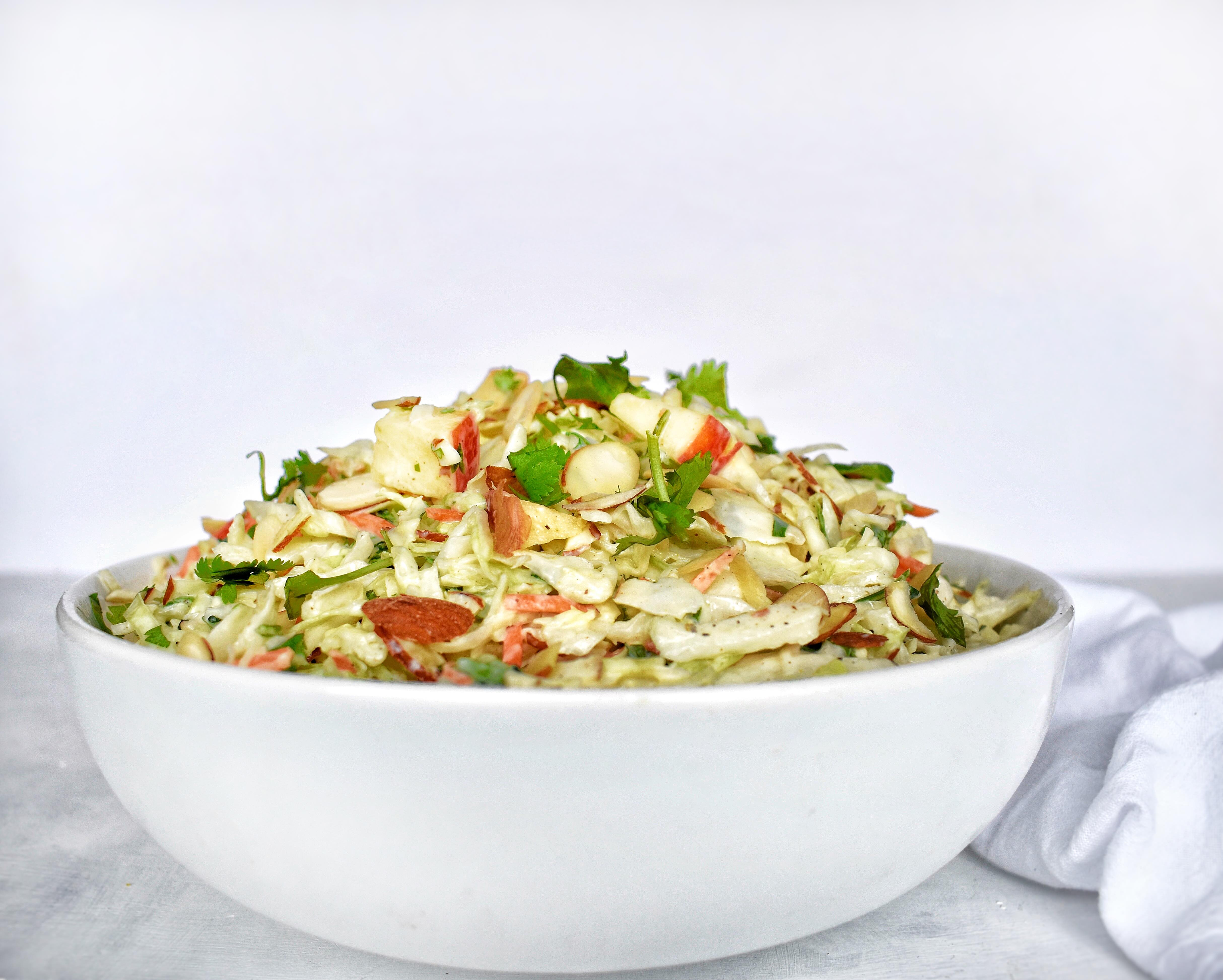 apple cilantro lime coleslaw in a bowl