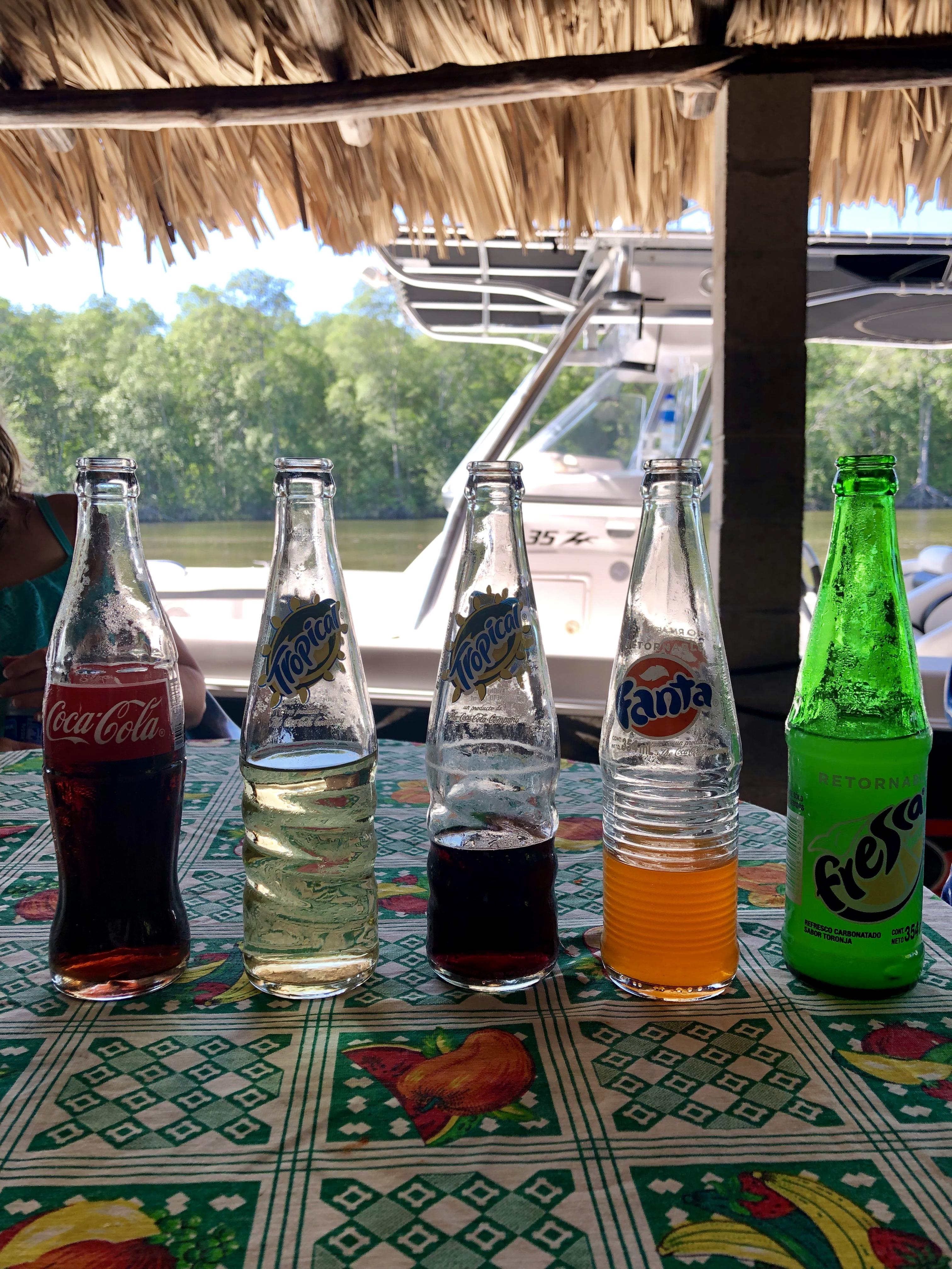 soda bottles sitting on table