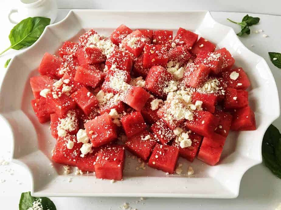 plater of watermelon chunks sprinkled with feta cheese