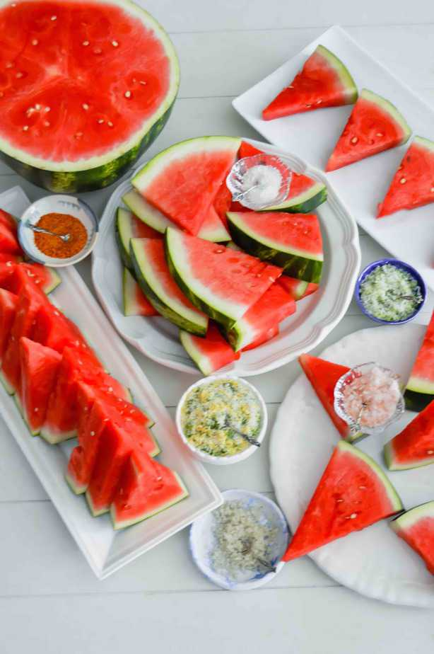 watermelon cut in assorted shapes served with flavored salts