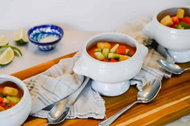 3 white bowls filled with Gazpacho, a cold soup from Spain