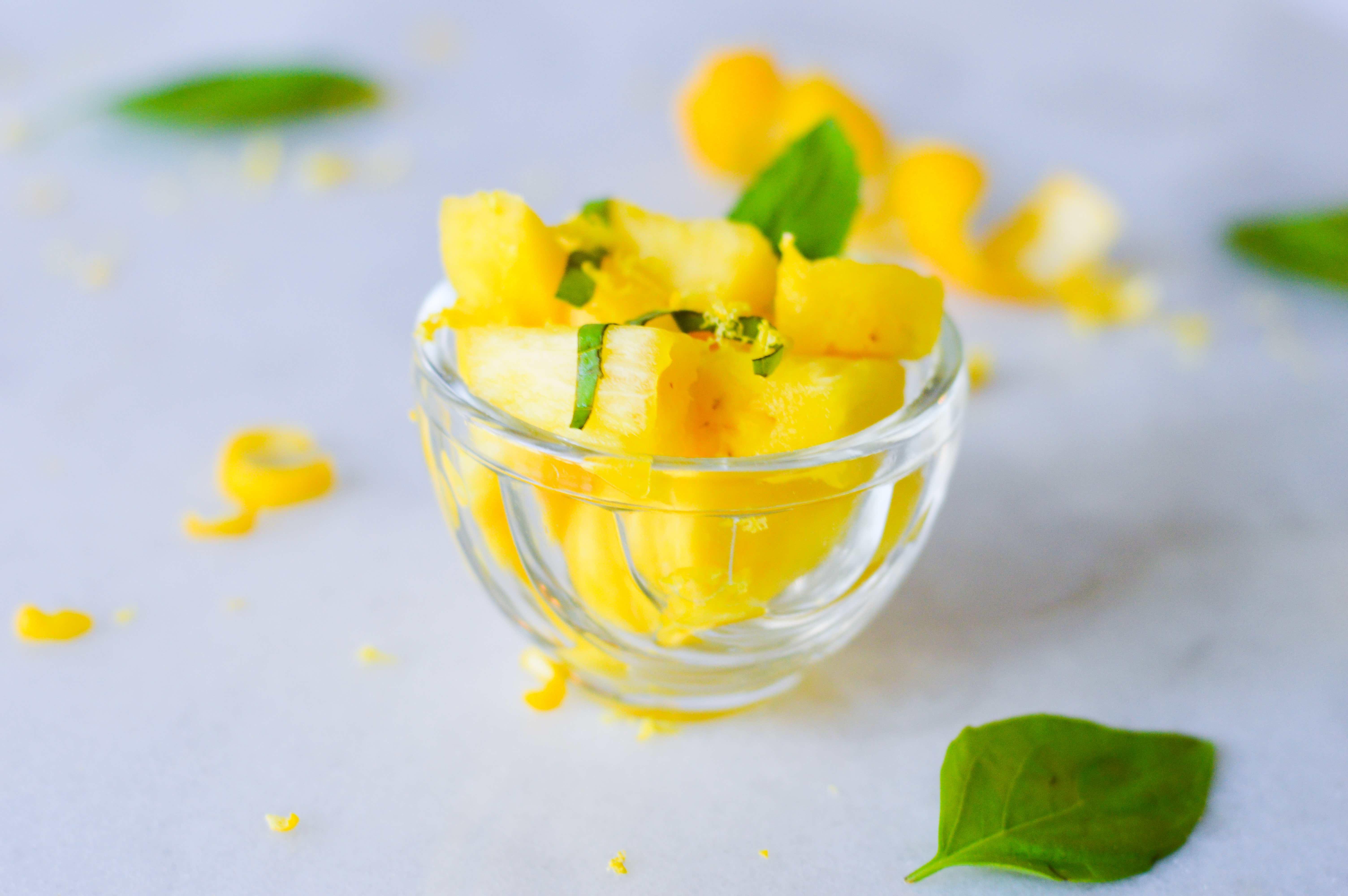 Fresh pineapple salad with basil and lemon