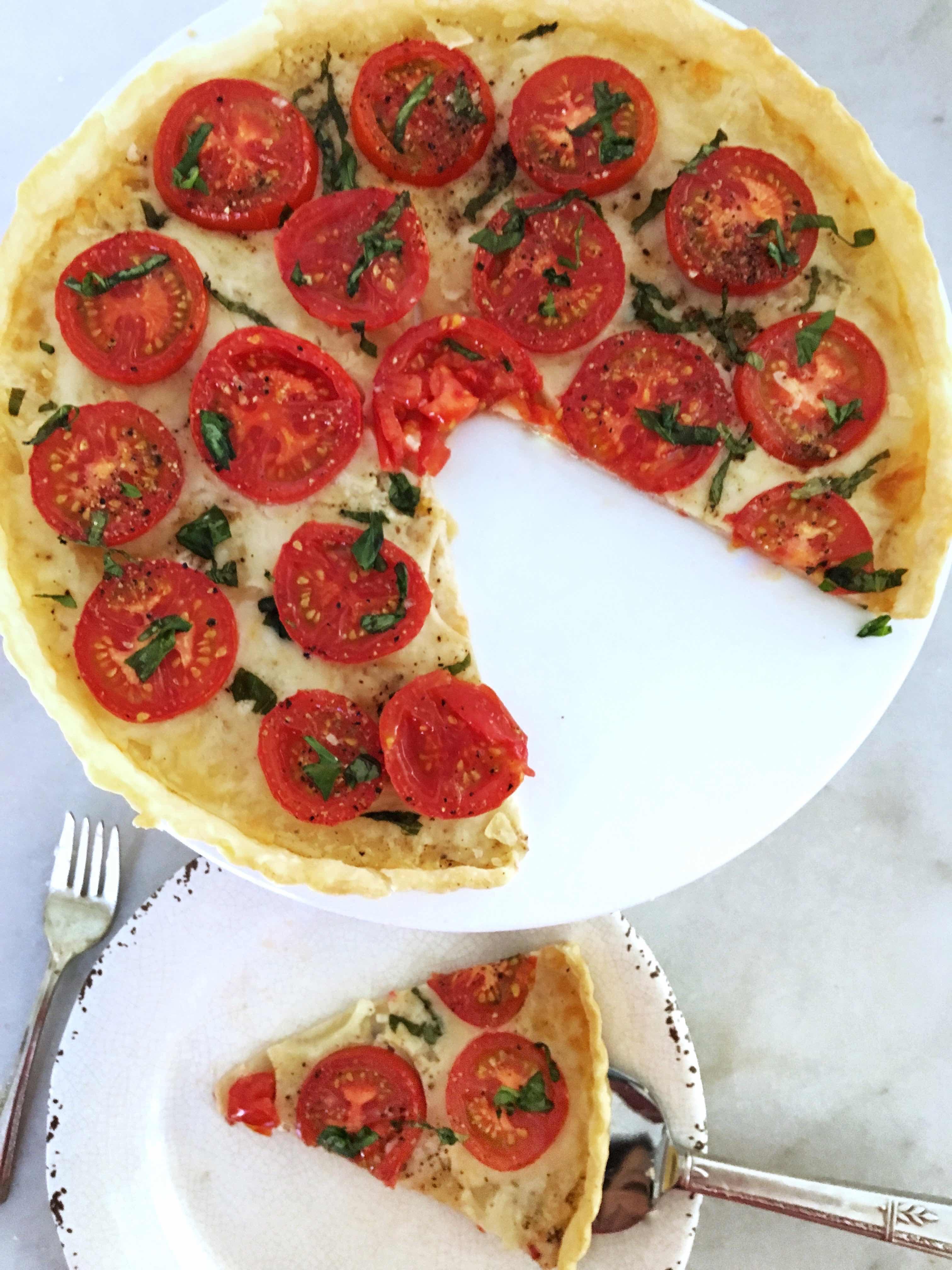 fresh tomato tart with mozzarella and basil. title