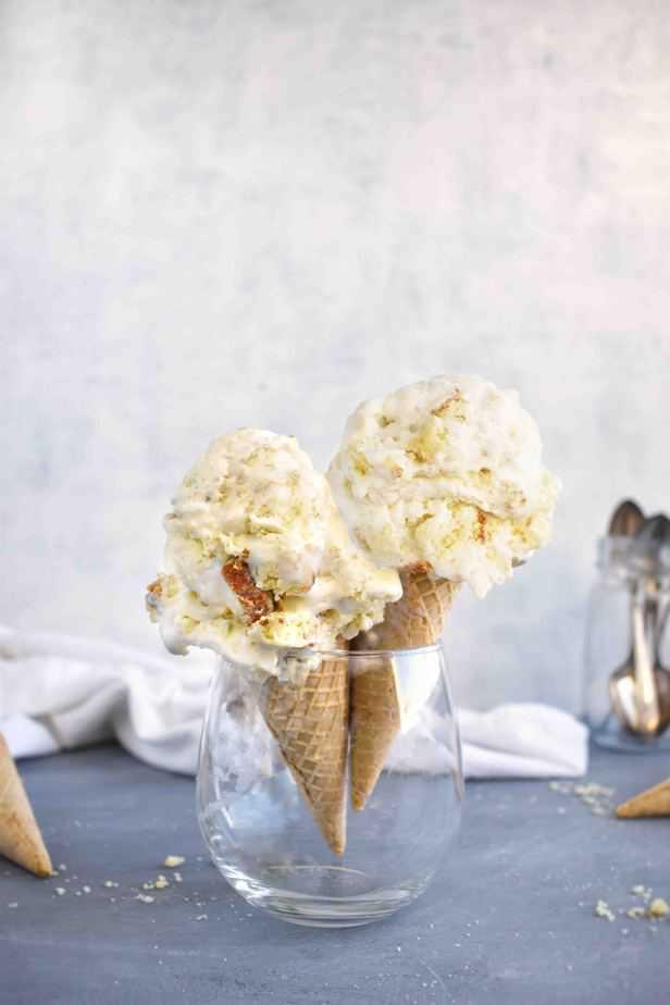 two ice cream cones in a glass
