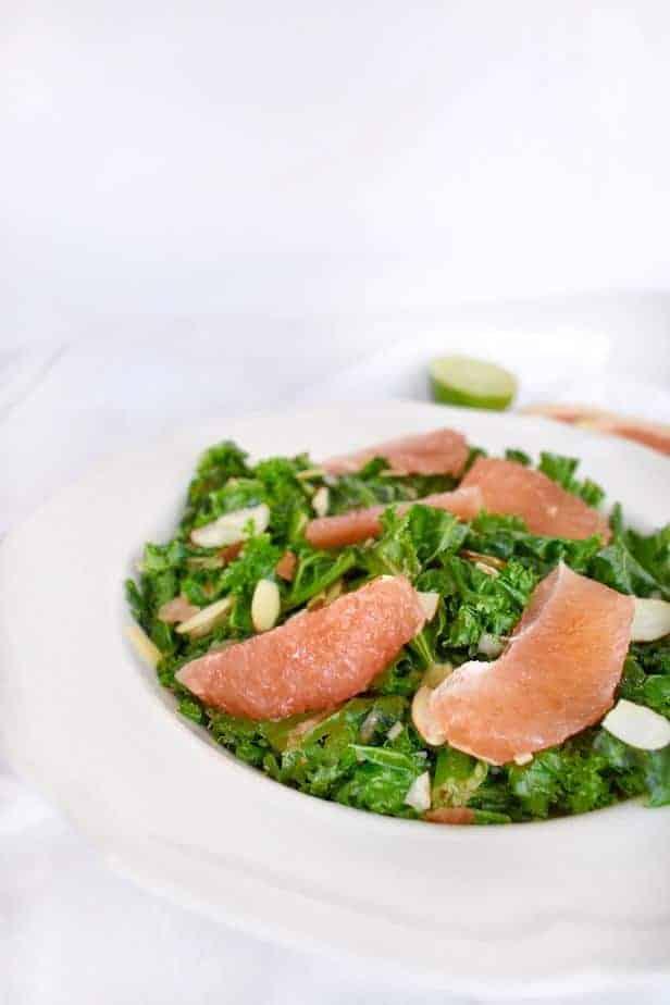 white bowl with roasted kale and fresh grapefruit salad