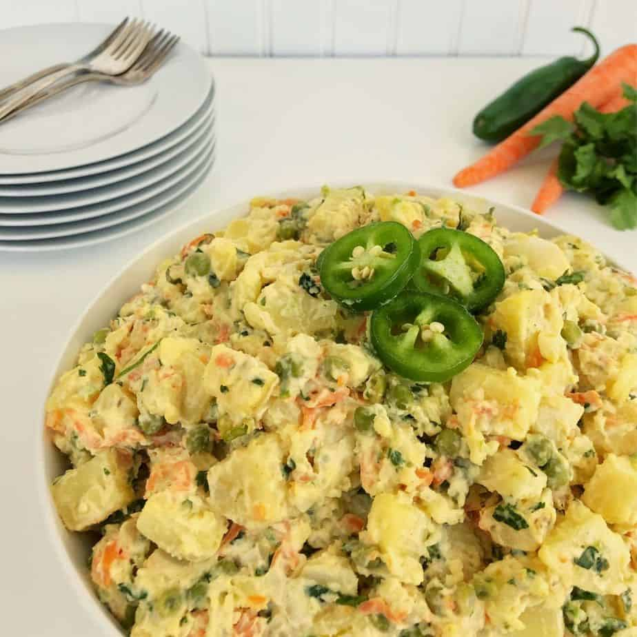 white bowl filled with jalapeno potato salad. featured image