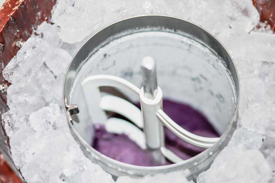 ice cream canister set in ice and filled with blackberry sherbet