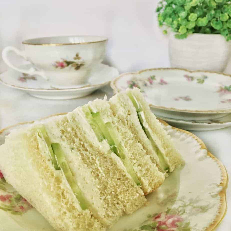 sliced cucumber sandwiches on china plate for tea or luncheon