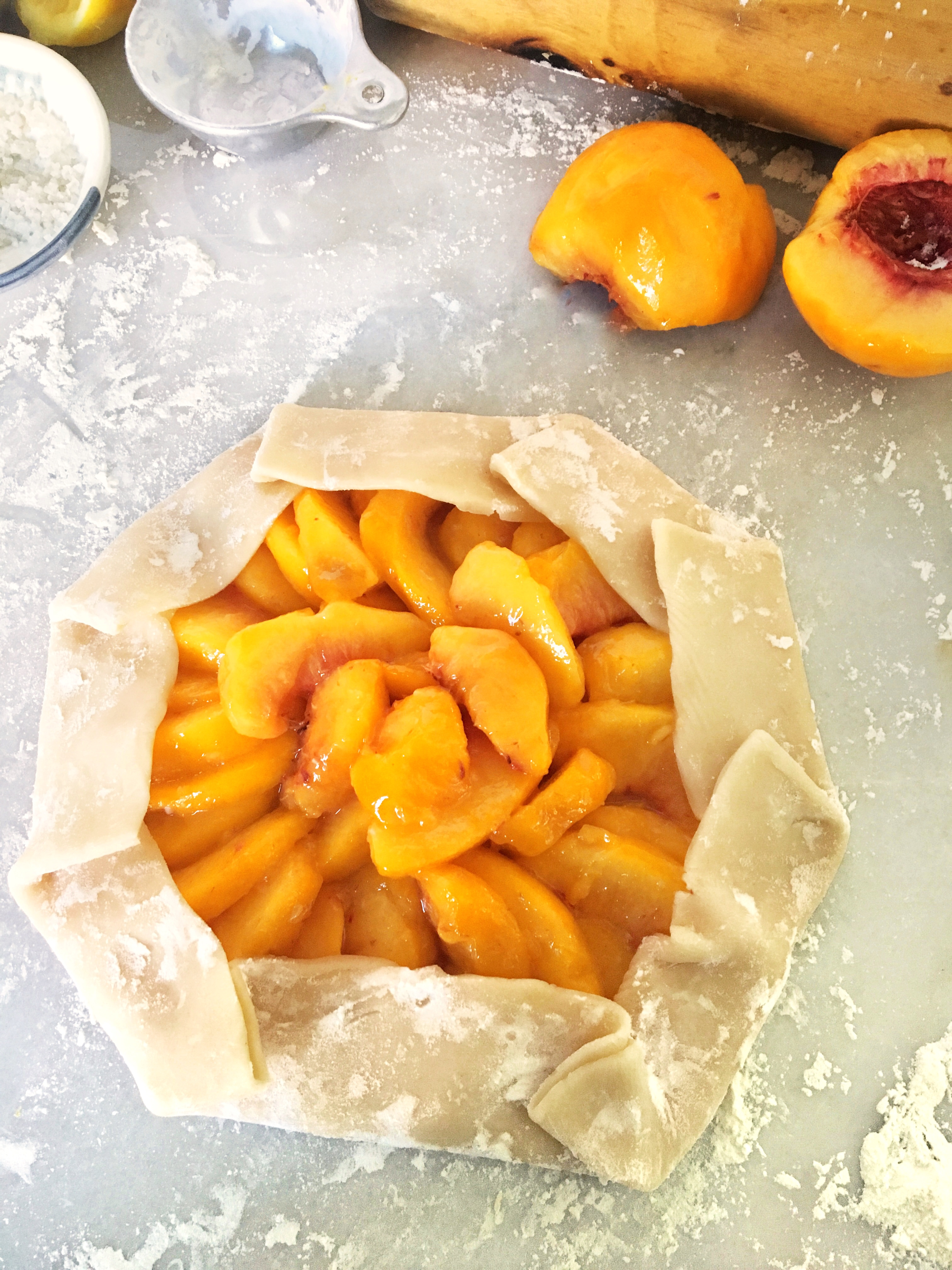 Fresh peaches arranged in a pastry crust