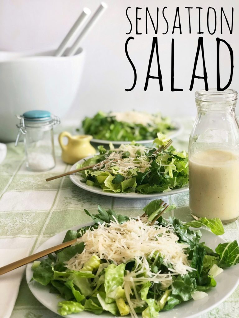 crisp greens and garlic lemon dressing with parmesan cheese title. Sensation Salad