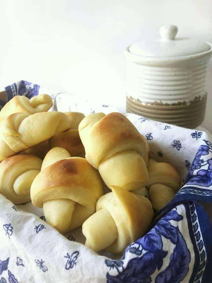 homemade dinner rolls in napkin lined basket