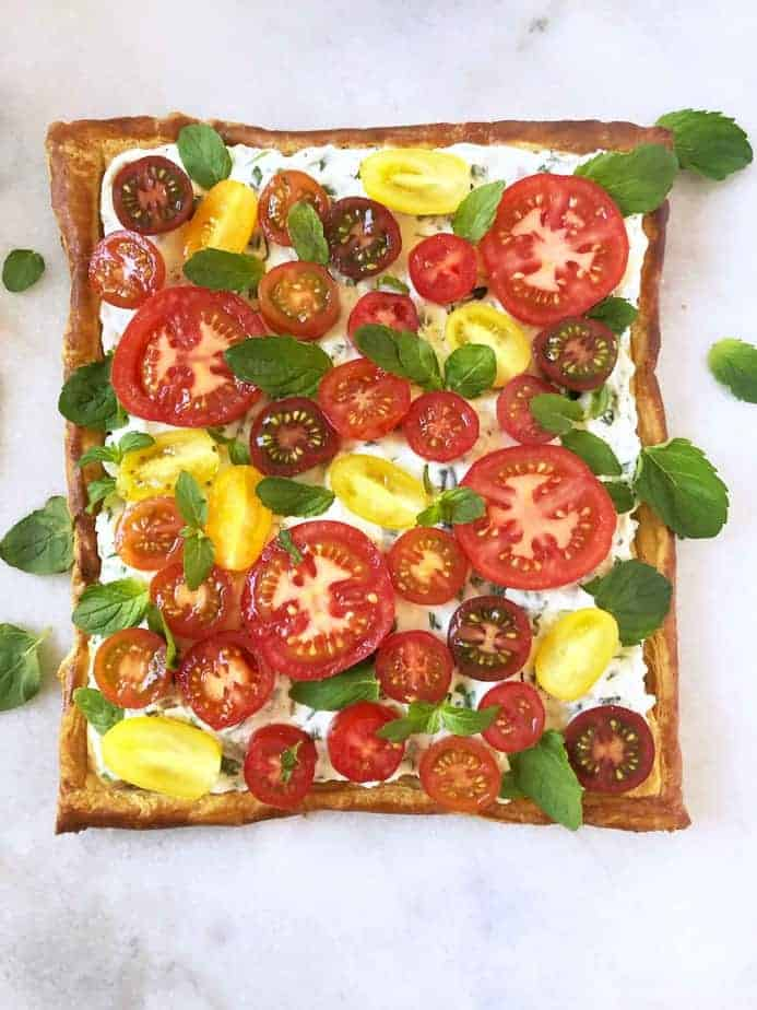 puff pastry spread with herbed ricotta cheese and topped with heirloom tomatoes