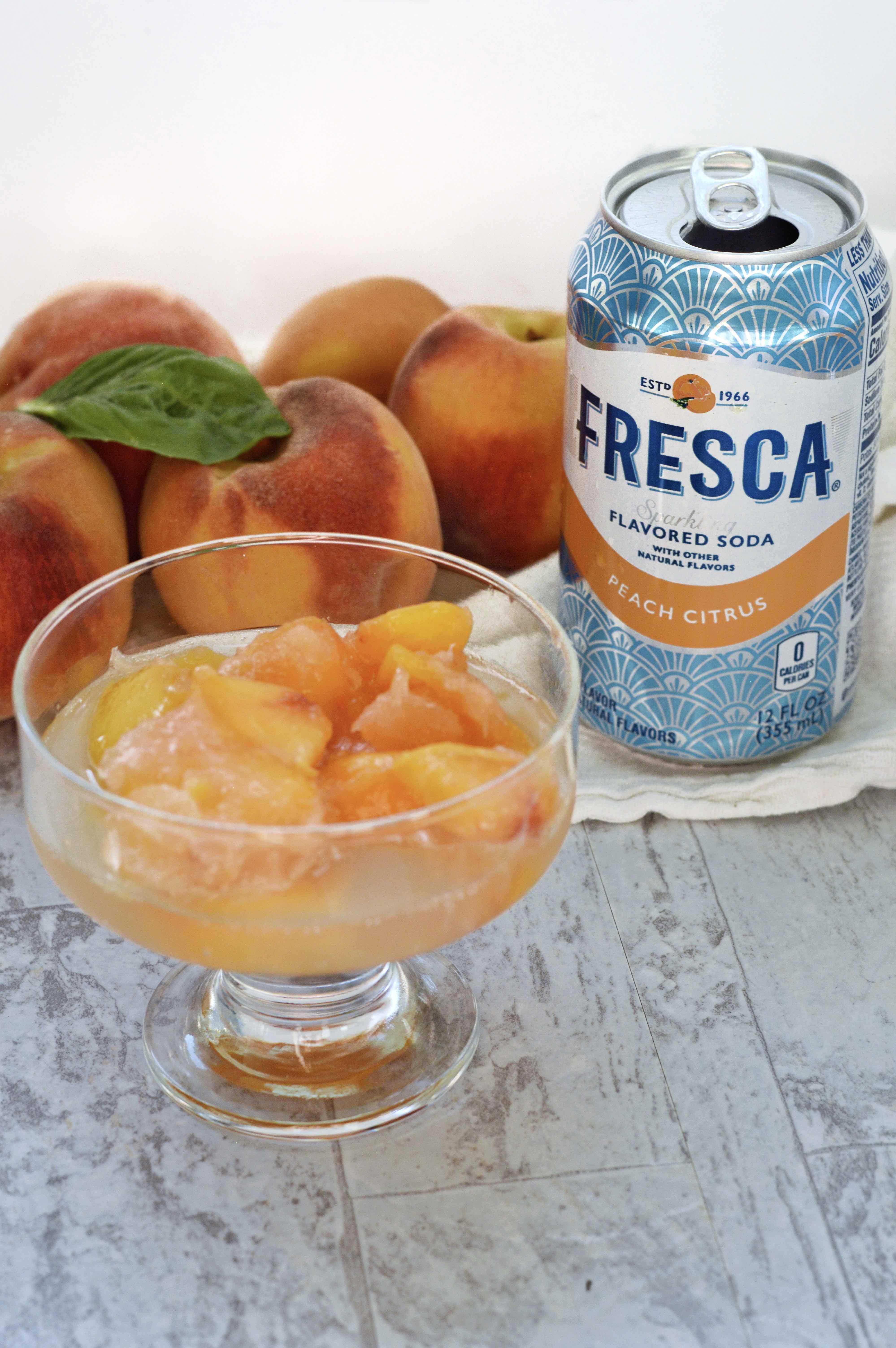 bowl of peach slush with Fresca and peaches