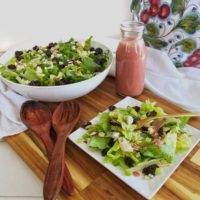 serving bowl and salad plate with cherry salad and vinaigrette