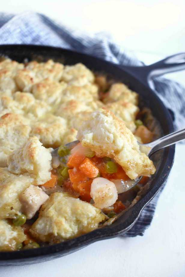 spoon scooping out portion of pot pie