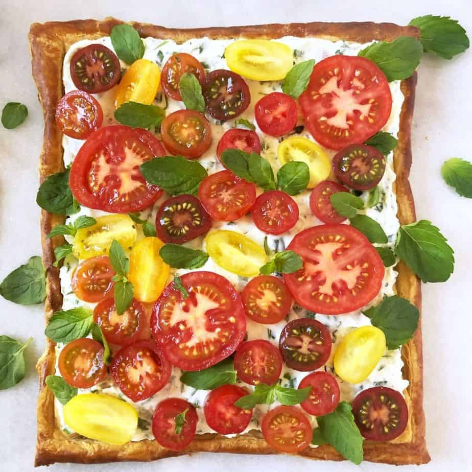 puff pastry appetizer tomato tart with ricotta cheese and herbs for brunch or side dish.
