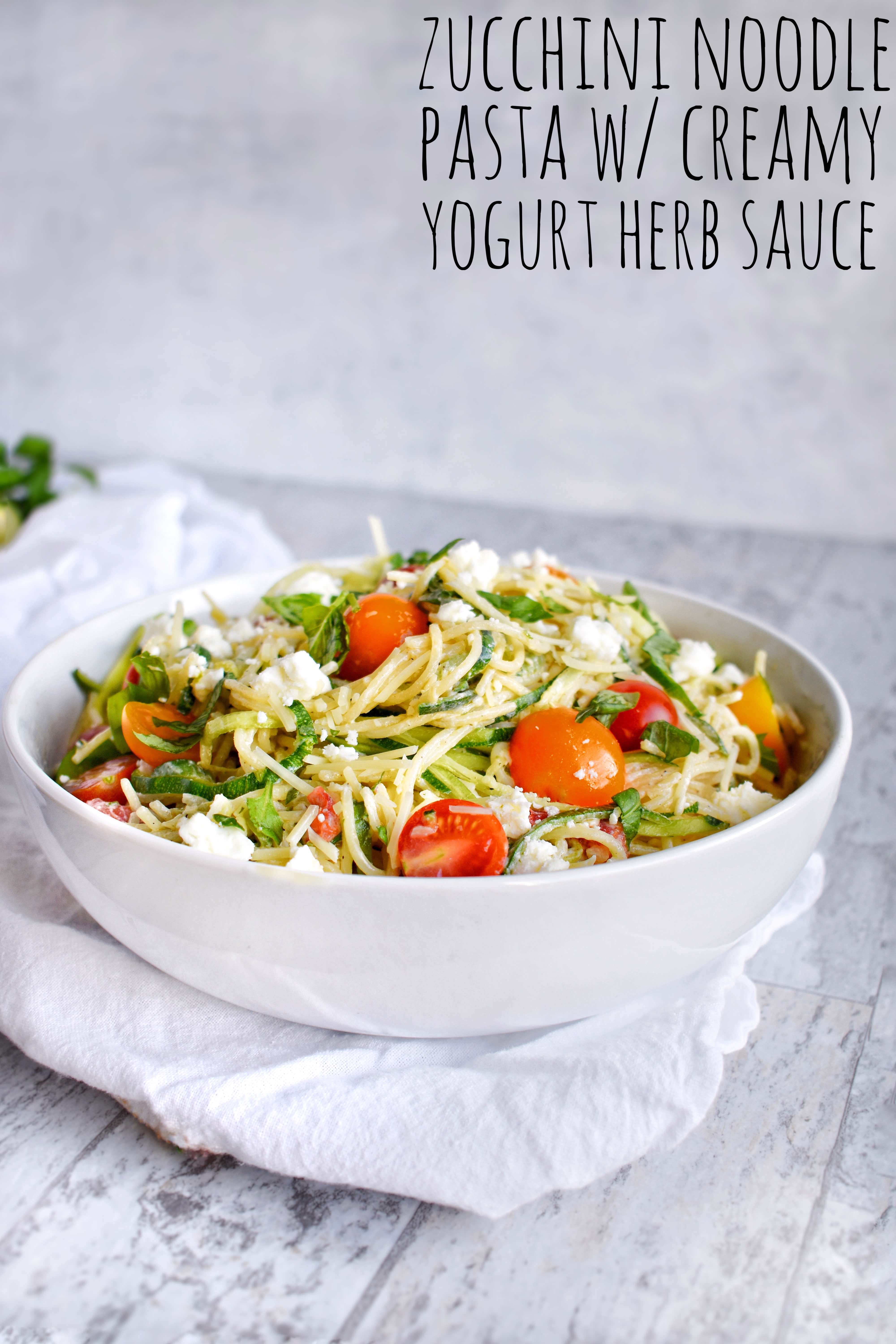 zoodle pasta with yogurt herb sauce in white bowl with title