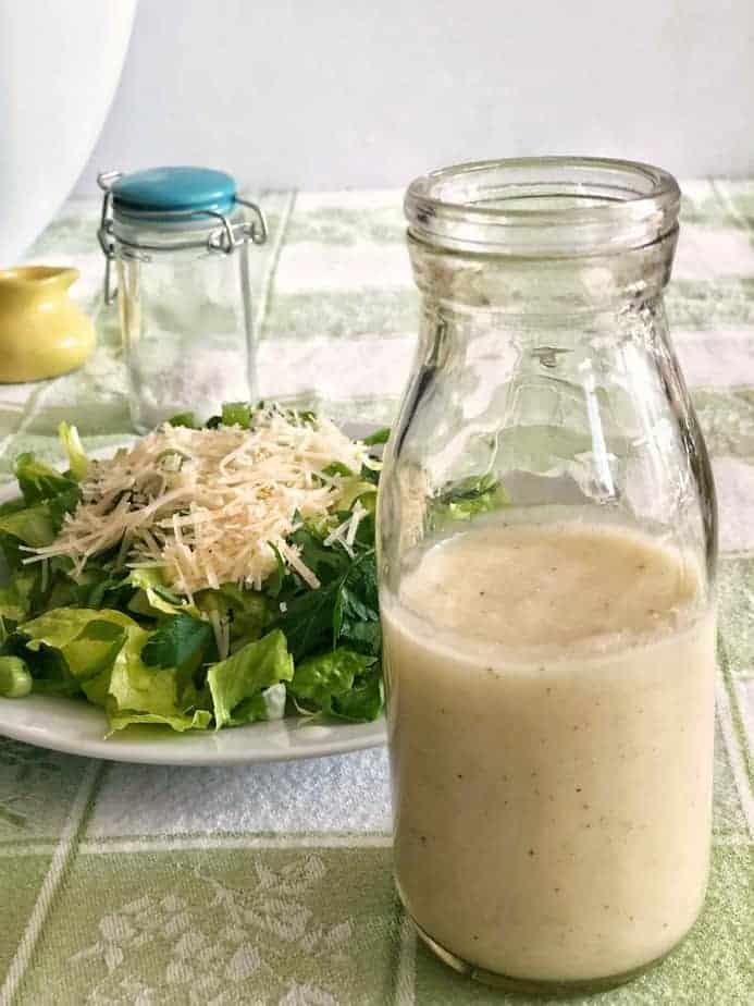 bottle of Sensation Salad Dressing with plate of salad
