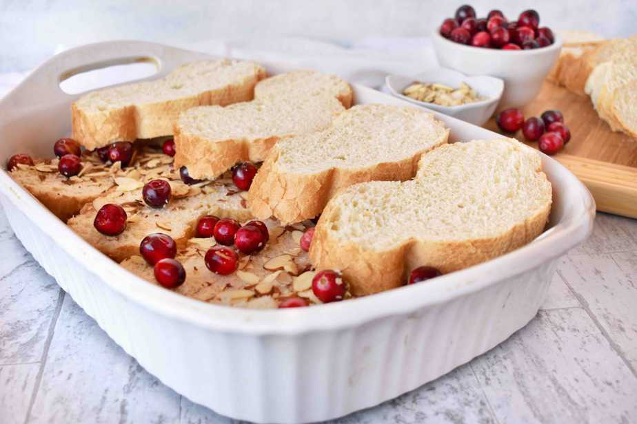 layering the bread for cranberry almond baked french toast