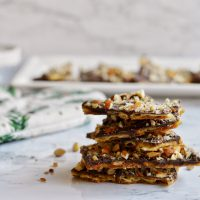 stack of soda cracker toffee with platter in backgound