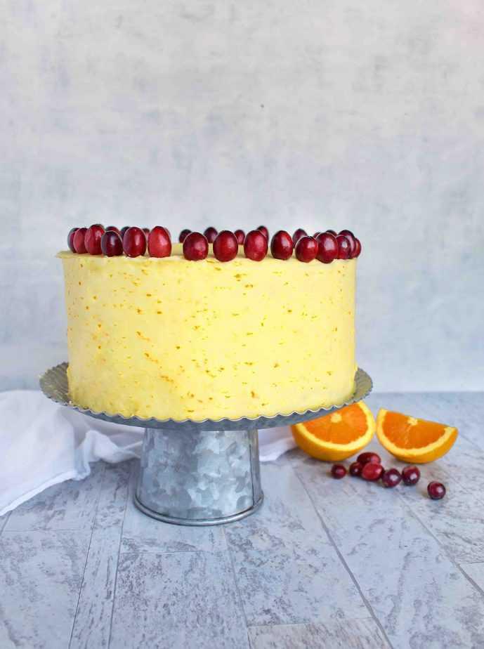 cranberry orange brown sugar cake on cake stand