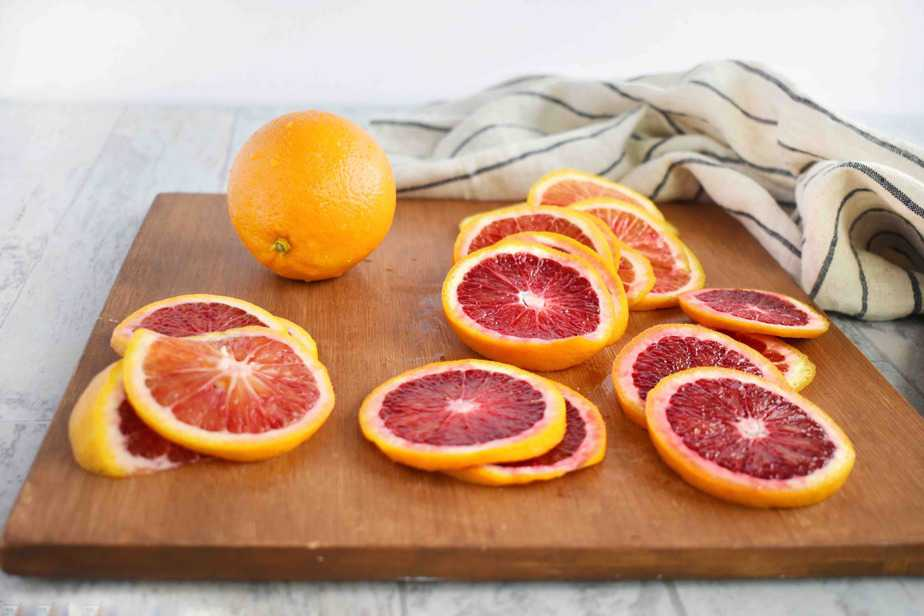 slices of blood oranges on on wooden board