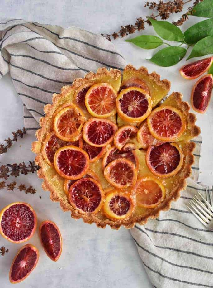 Blood orange shaker tart, full tart with orange slices on side