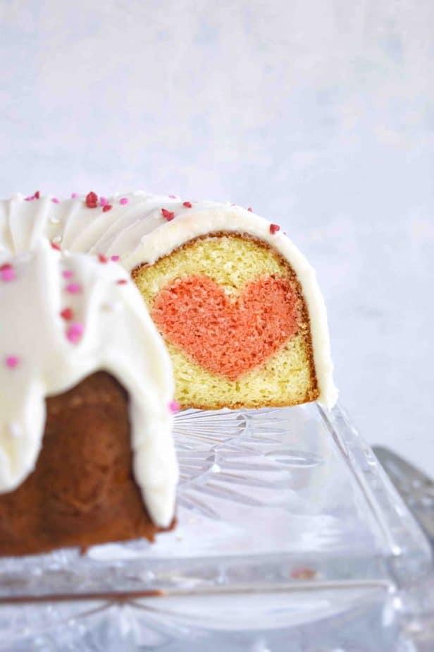 sliced open bundt cake showing heart inside