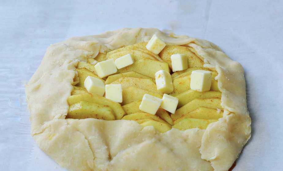 apple slices in pastry crust dotted with butter