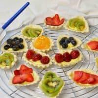 painting glaze on fresh fruit tarts