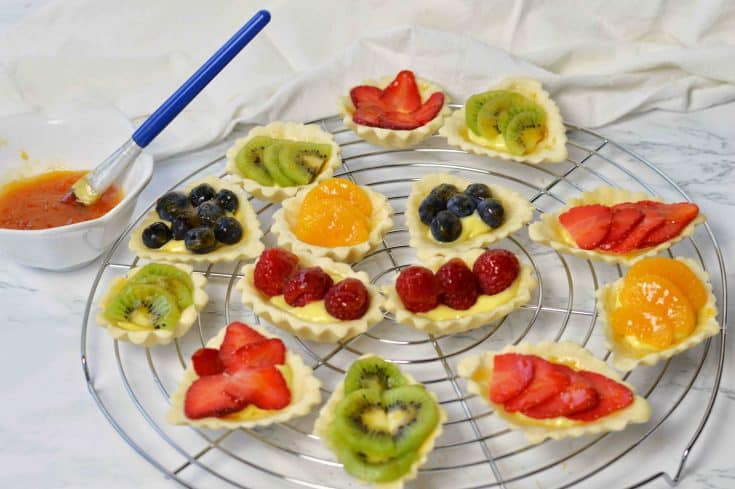 painting glaze on fresh fruit tarts