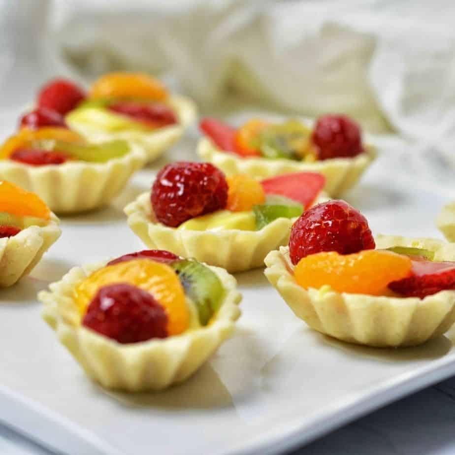 Mini Tart shells filled with fruit and custard.