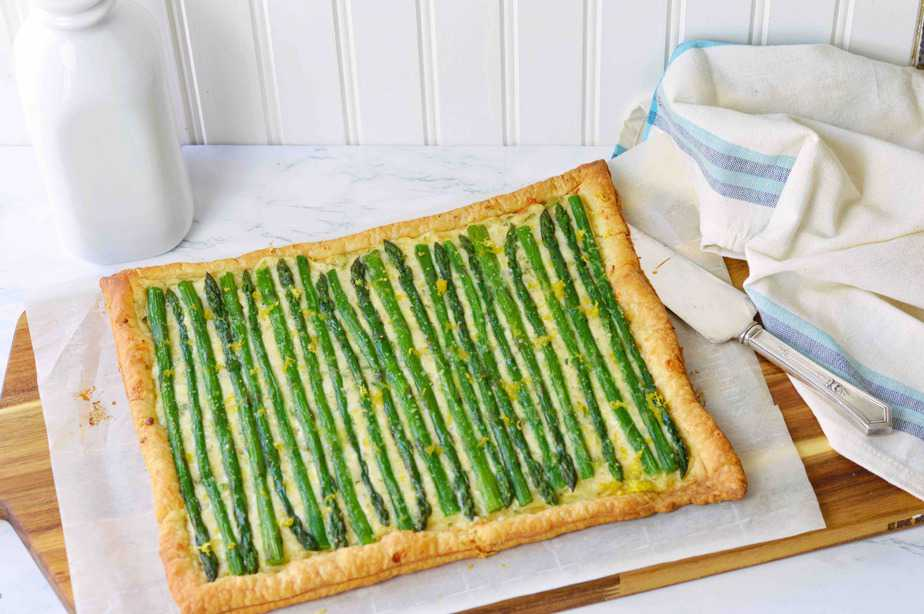 asparagus cheese tart with milk bottle on cutting board