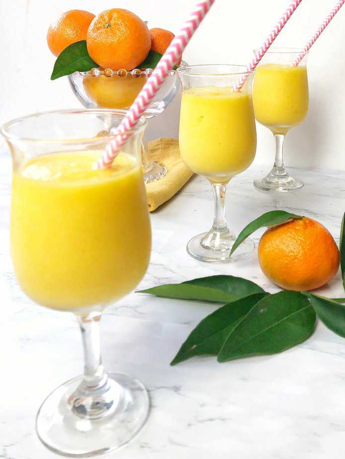 3 glasses filled with orange mango freeze