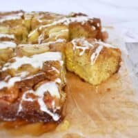 slices of banana upside down cake with cream cheese glaze