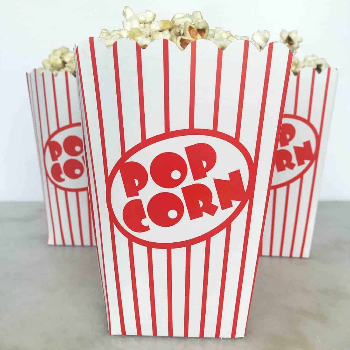 red and white striped popcorn containers in triangle shape.