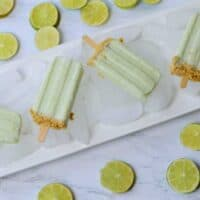 platter with ice and 4 key lime pie popsicles