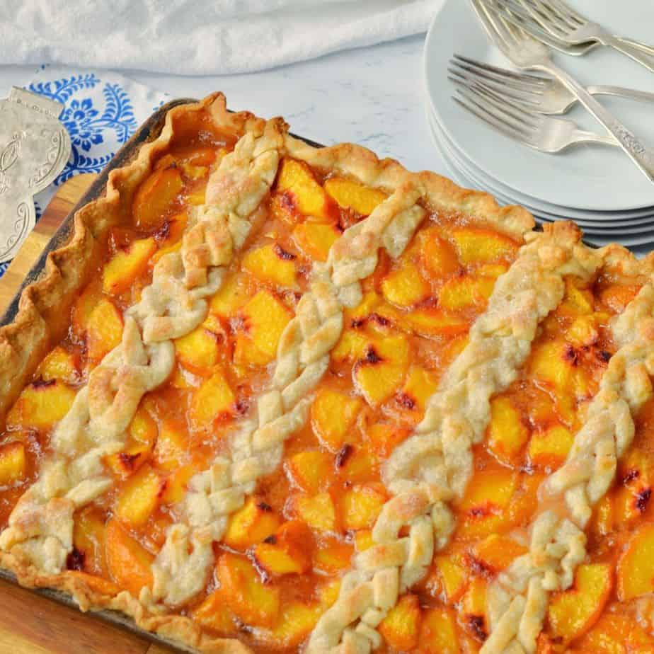 easy peach slab pie in a sheet pan with braided crust on top