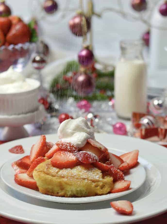 Fluffy French toast on white plate with Christmas decor