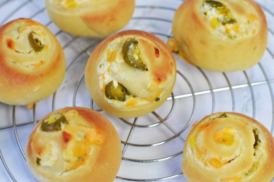 jalapeno popper rolls on round wire rack