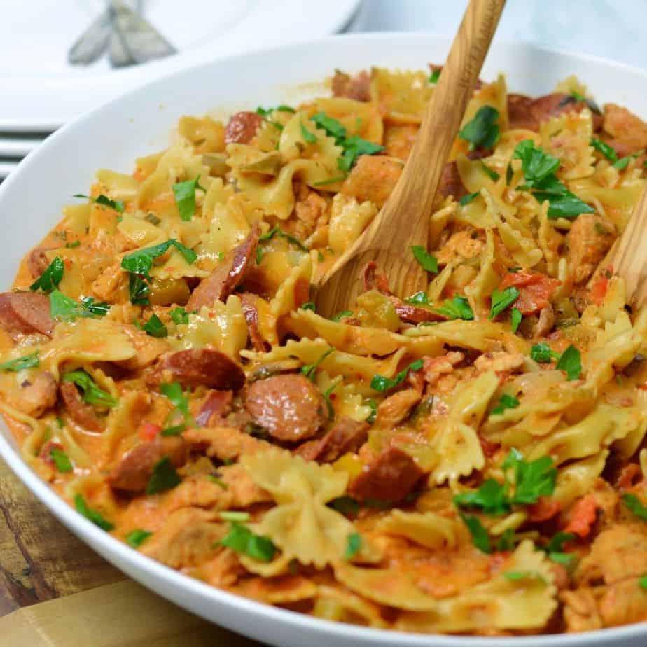 Cajun chicken pasta in white bowl