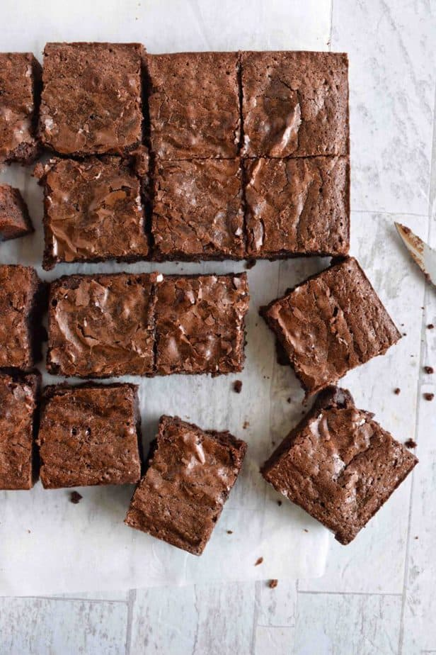 brownies squares all lined up with one or two scattered off kilter
