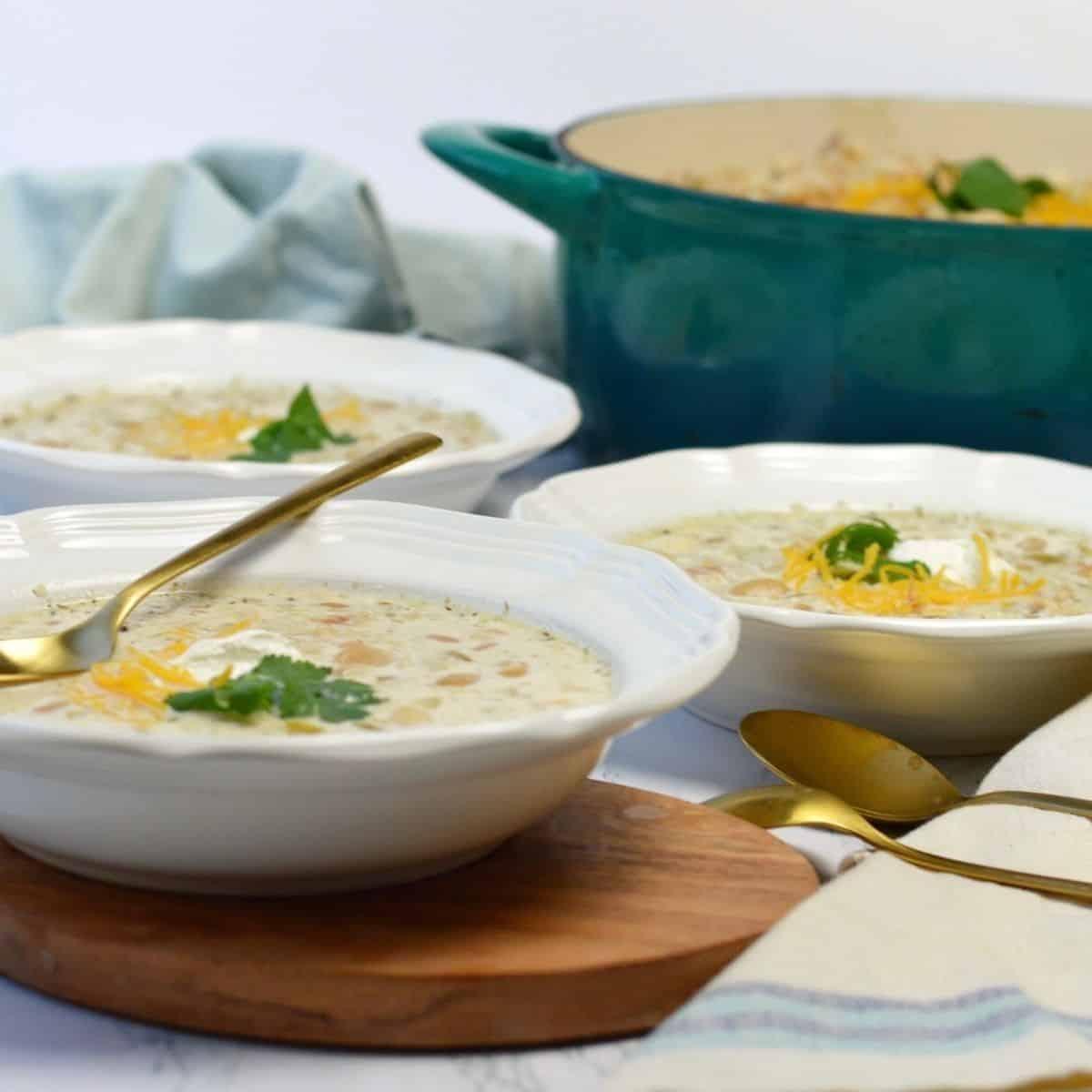 3 white bowls of white bean chicken chili.