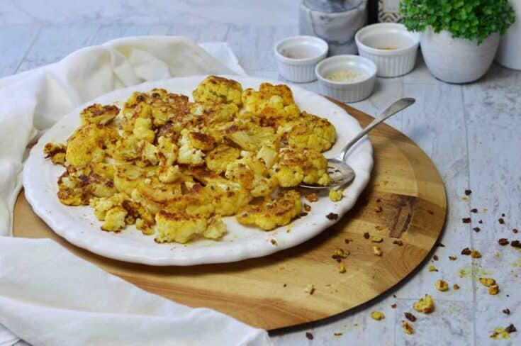 white platter with roasted curry cauliflower bites.