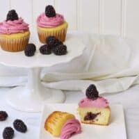 berry cupcakes on white cake platter