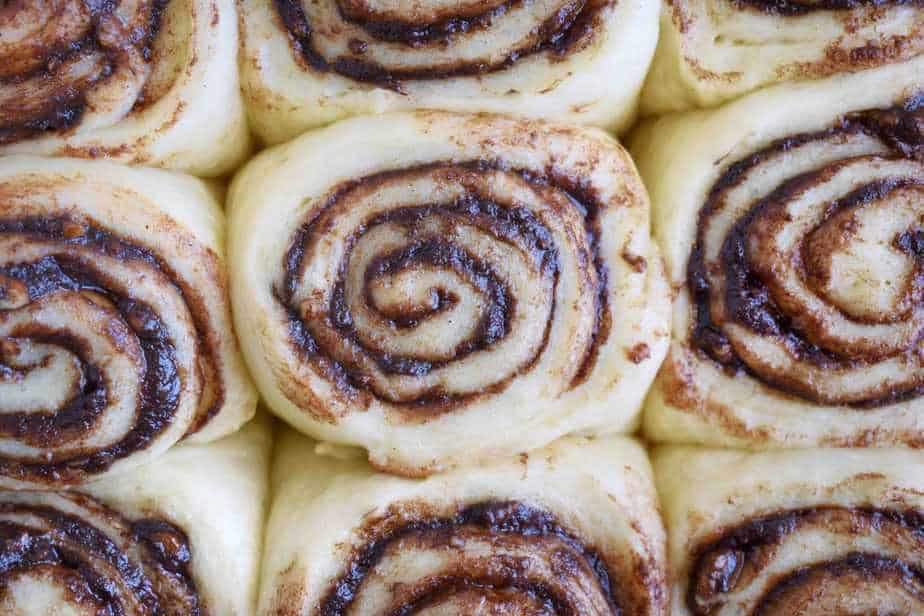 cinnamon roll dough slices in pan