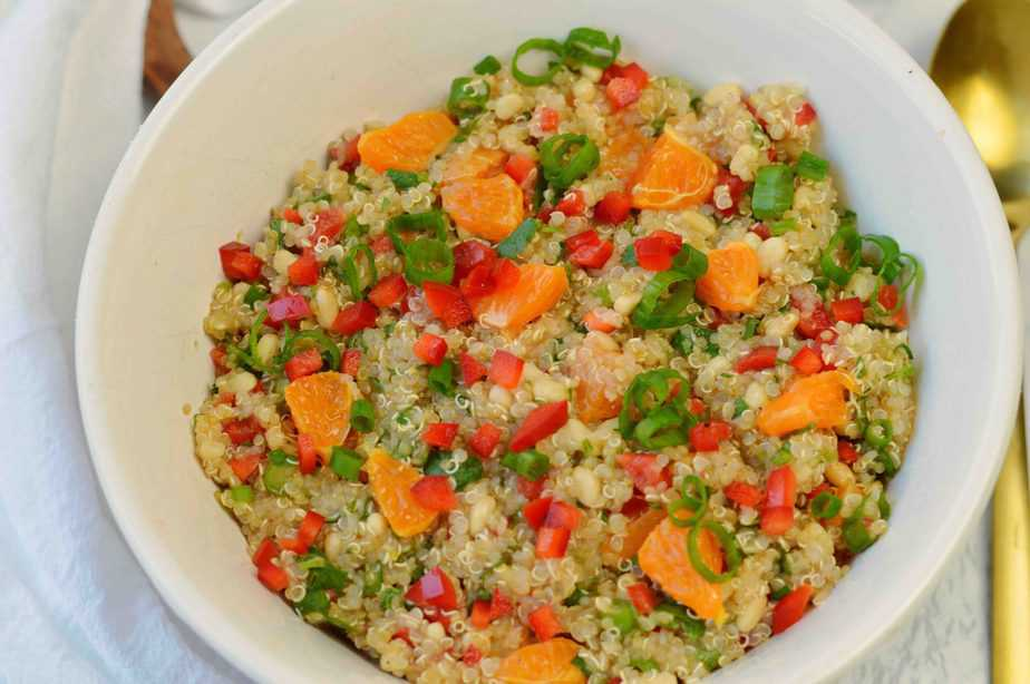 bowl of fresh fruit and vegetables mixed with quinoa for healthy quinoa salad recipe