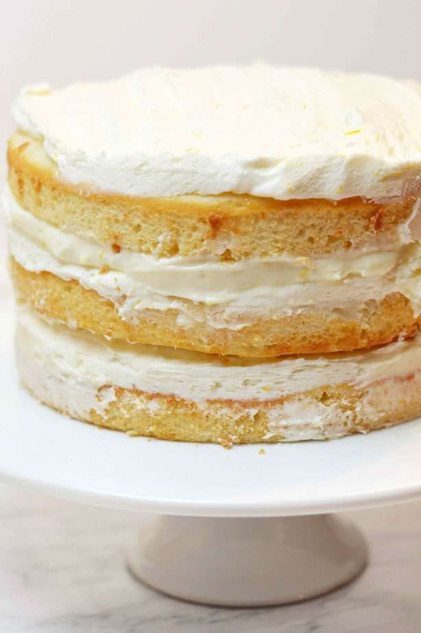 3 layers of cake with filling and frosting on top make a naked cake